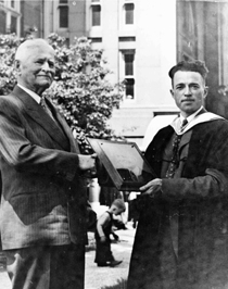 Image of Edwin C Burke receives plaque from D_J_Strickler ca1940s