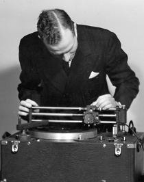 Image of Ray H Moore with first recording equipment 1941